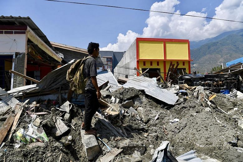 Traumatised kids sleep in the open as rescuers race against clock after quake-tsunami disaster in Indonesia