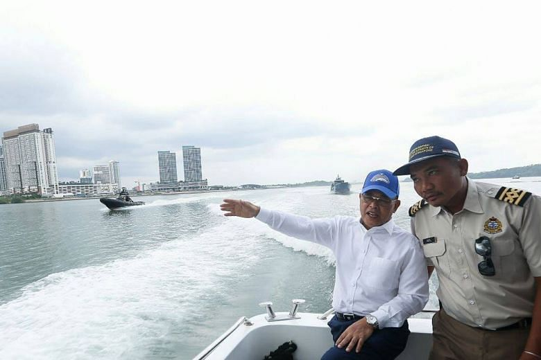 Five Malaysian government vessels in Singapore waters on Wednesday