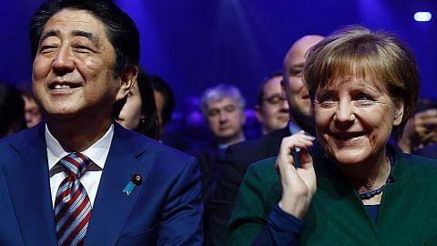 Merkel, Abe pertahan dagangan bebas