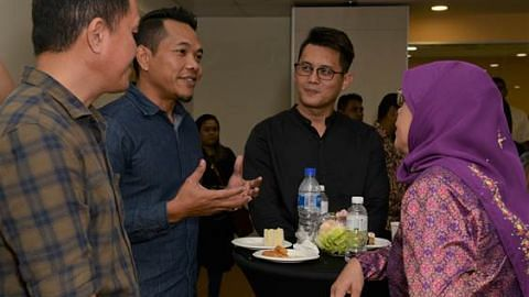 President Halimah at a tea and engagement session with SANA's clients / ex-offenders. From left: Alvin Chiong, Mustakeem Rais, Jabez Koh.  All three men are leading successful lives.