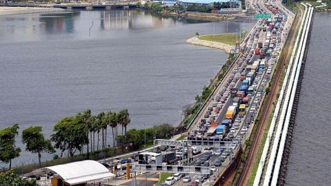 3-hour customs queues as travellers head across Causeway for Chinese New Year