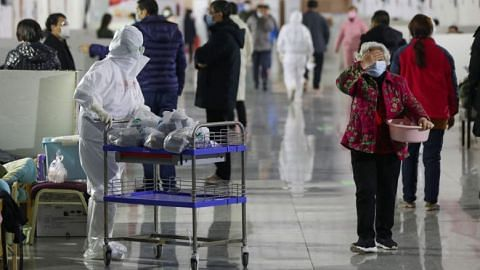 China reports fewer coronavirus cases outside epicentre, cases surge in South Korea
