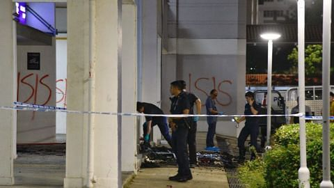 Man detained over fire, 'ISIS' graffiti outside police post in Boon Keng