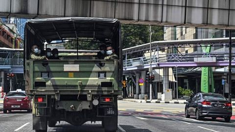 Coronavirus: Malaysian soldiers on streets to assist cops in enforcing movement curbs
