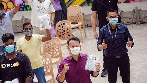 Zaqy agih 1,000 pelitup guna semula kepada pekerja asing