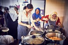 Britain's Meghan launches Grenfell cookbook