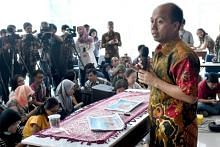 Dying of cancer, but Indonesia's disaster spokesman battles to tell world about quake-tsunami