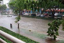 Flash floods hit parts of Singapore, including KPE, due to heavy downpour