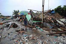 Indonesian tsunami: Torrential rains pound villages, hampering aid efforts in coastal areas around Sunda Strait