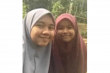 Sisters killed in Malaysia fire while parents were out preparing food for firefighters