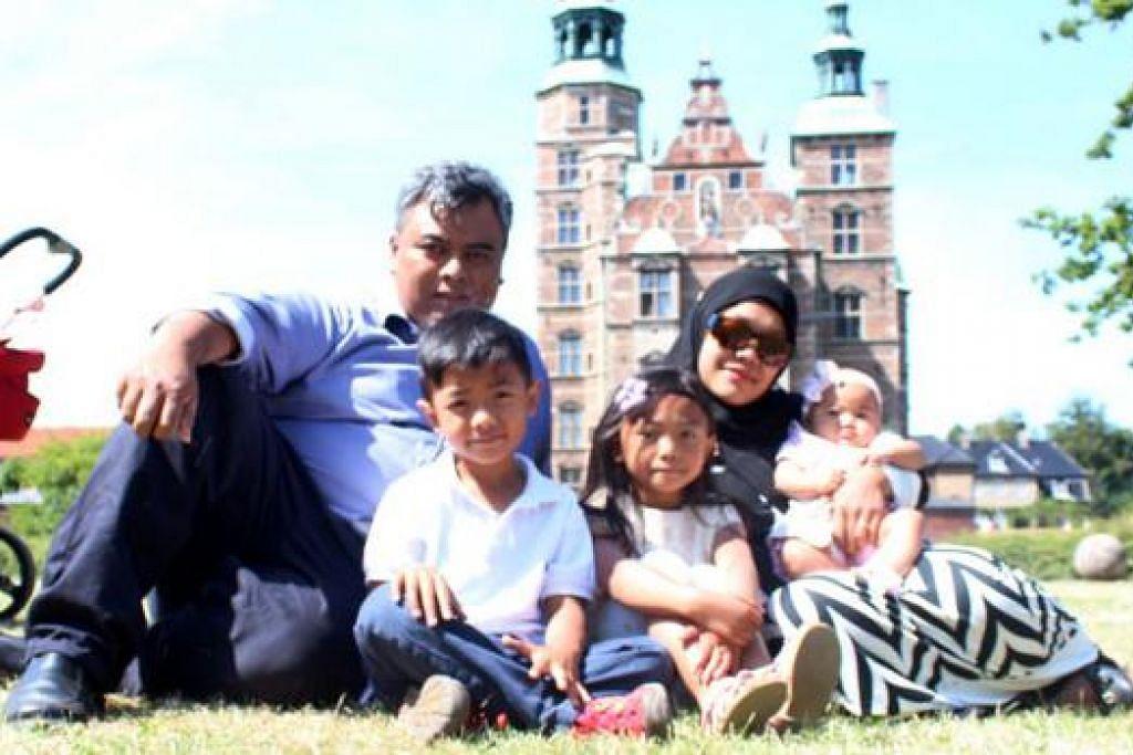 JAUH DI EROPAH: (Dari kiri) Encik Isrin Ismail, Izz Danish Isrin, Sofea Dhaniyah Isrin, Cik Sharlynne Suzanna Samawi dan Iyesha Syarifah Isrin bergambar di Denmark baru-baru ini.– Foto ihsan SHARLYNNE SUZANNA SAMAW