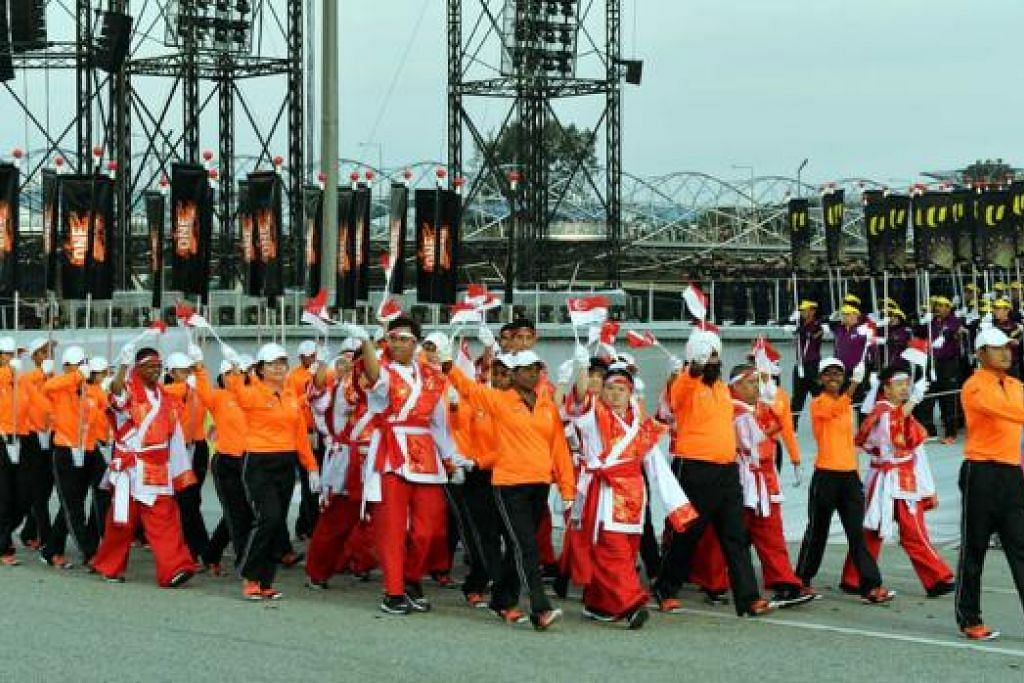 INKLUSIF: Buat julung-julung kalinya, peserta Minds juga ikut berbaris bersama kontinjen OnePeople.sg tahun ini.