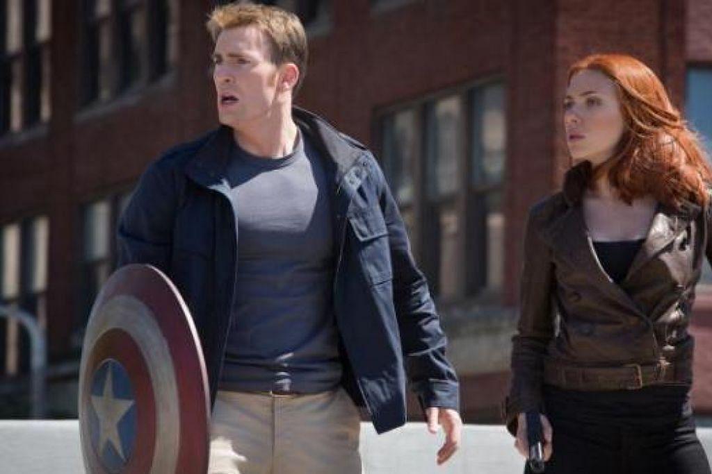 ANTARA YANG LASAK: Filem 'Captain America: The Winter Soldier' lakonan Scarlett Johansson dan Chris Evans (kiri) memaparkan watak lasak Scarlett. - Foto DISNEY