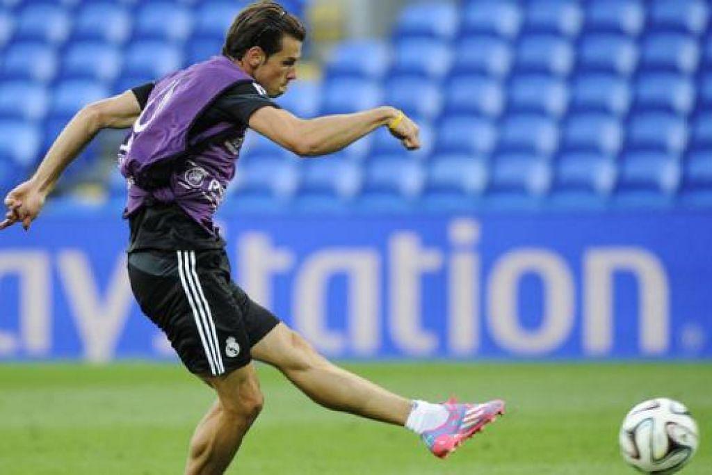 BERAZAM TINGGI: Gareth Bale berlatih dalam satu sesi menjelang perlawanan Real Madrid dengan Sevilla yang berlangsung semalam. – Foto REUTERS