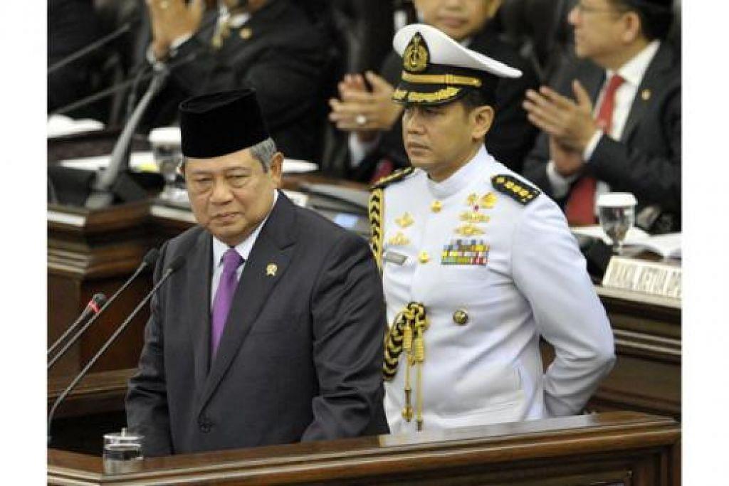 PIDATO KENEGARAAN: Presiden Susilo Bambang Yudhoyono memberi ucapan terakhir di Parlimen semalam. - Foto AFP
