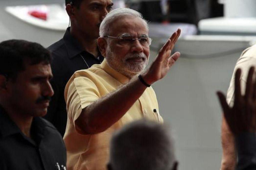 PEKEMBANGAN POLITIK POSITIF: Encik Narendra Modi menjadi Perdana Menteri baru India baru, dan Encik Lee ingin bekerjasama lebih rapat dengan beliau dan India.