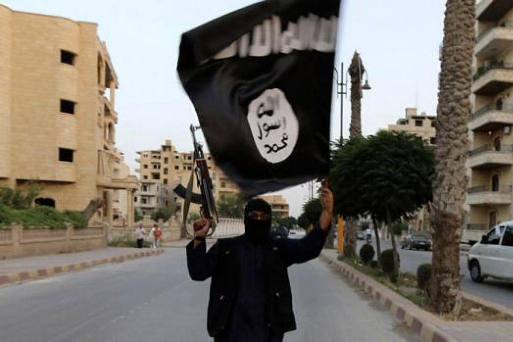 PANJI HITAM: Panji hitam yang digunakan oleh militan IS. – Foto fail