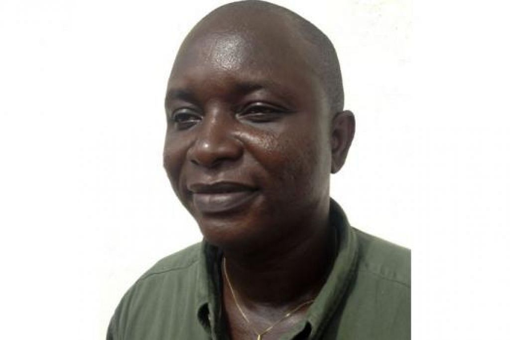 WIRA DIKENANG: Inilah wajah ketua doktor yang berjuang menentang wabak Ebola di Sierra Leone, Dr Sheik Umar Khan.  - Foto REUTERS