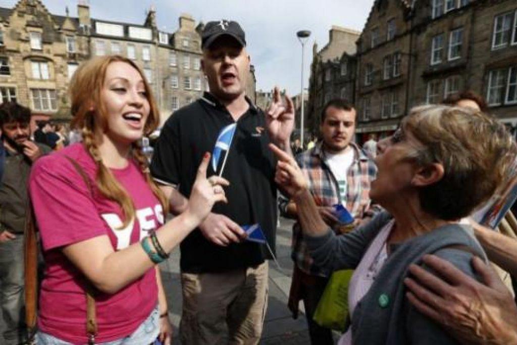 GIAT BERKEMPEN: Kedua-dua pihak kempen 'Ya' dan 'Tidak' menggiatkan usaha di Edinburgh, Scotland, semalam. Scotland akan mengundi minggu depan bagi menentukan sama ada mengisytiharkan kemerdekaan ataupun tidak. - Foto REUTERS