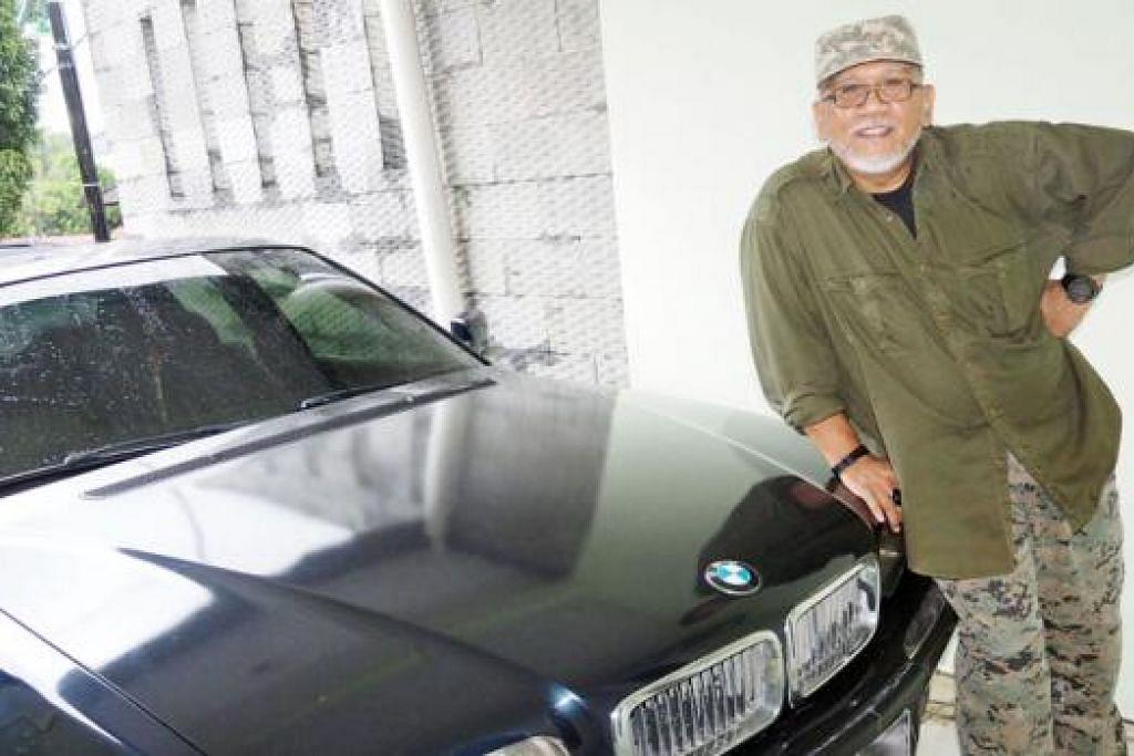 MASIH TERBAWA-BAWA SIKAP EJEN PENYULUH RAHSIA: Encik Andy Zulkifli bersama kereta BMW bersiri tujuh kalis peluru yang diletakkan di rumah keduanya di Tiban, Batam.