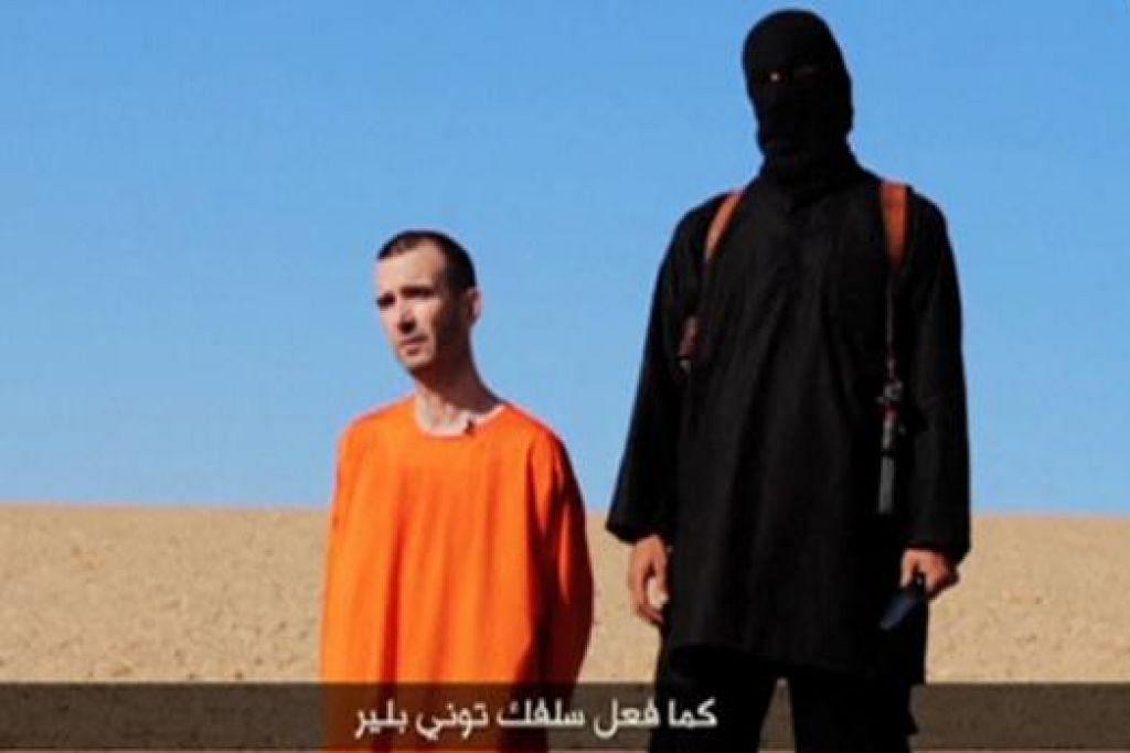 JADI MANGSA KETIGA: Rakaman video ini menunjukkan warga Britain, David Haines, sebelum kepalanya dipenggal militan IS. - Foto REUTERS
