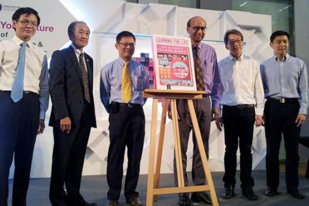 PELANCARAN PELAN INDUK CET: Encik Tharman (tiga dari kanan) merasmikan Pelan Induk Pendidikan dan Latihan Berterusan (CET) serta Institut Pembelajaran Sepanjang Hayat. Antara yang hadir di majlis pelancaran itu ialah Ketua Pergerakan Buruh, Encik Lim Swee Say (dua dari kanan), dan Menteri Tenaga Manusia, Encik Tan Chuan-Jin (kanan). - Foto NUR ADILAH MAHBOB