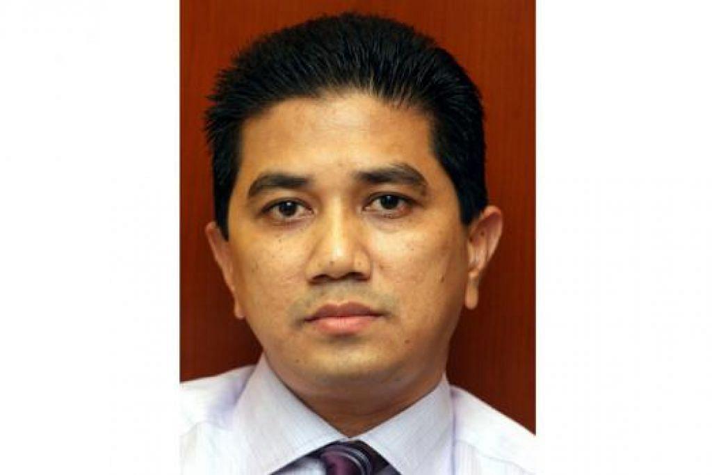 JAWAPAN DIKETAHUI SELASA INI: Menurut sumber istana, Dr Wan Azizah bukan Menteri Besar Selangor yang baru dan sebaliknya antara nama lain yang disebut dilantik jawatan itu ialah Encik Azmin (gamber atas). - Foto-foto fail