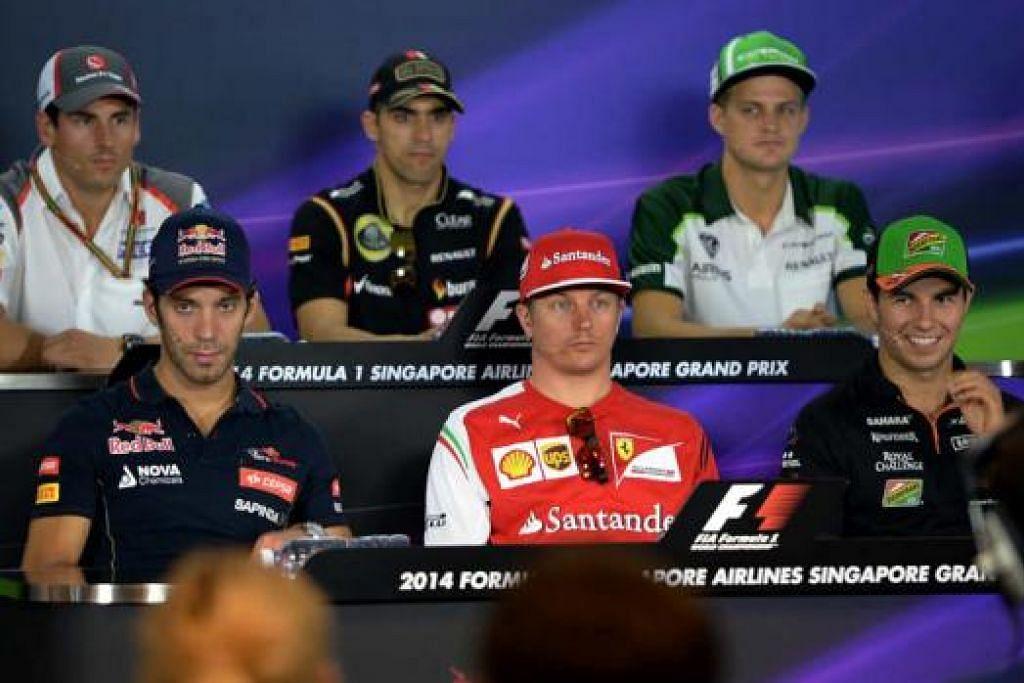 HADIRI SIDANG MEDIA: Para pemandu Formula 1 (depan, dari kiri) Jean-Eric Vergne (Toro Rosso), Kimi Raikkonen (Ferrari), Sergio Perez (Force India), (belakang, dari kiri) Adrian Sutil (Sauber), Pastor Maldonado (Lotus) dan Marcus Ericsson (Caterham) sedang melayani soalan wartawan dalam satu sidang media. – Foto ZAINAL YAHYA