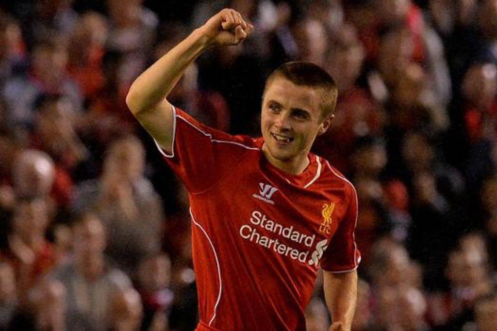 BAKAT MUDA: Pemain yang baru berusia 17 tahun, Jordan Rossiter, meraikan gol pembukaan Liverpool semasa menentang Middlesbrough. - Foto AFP