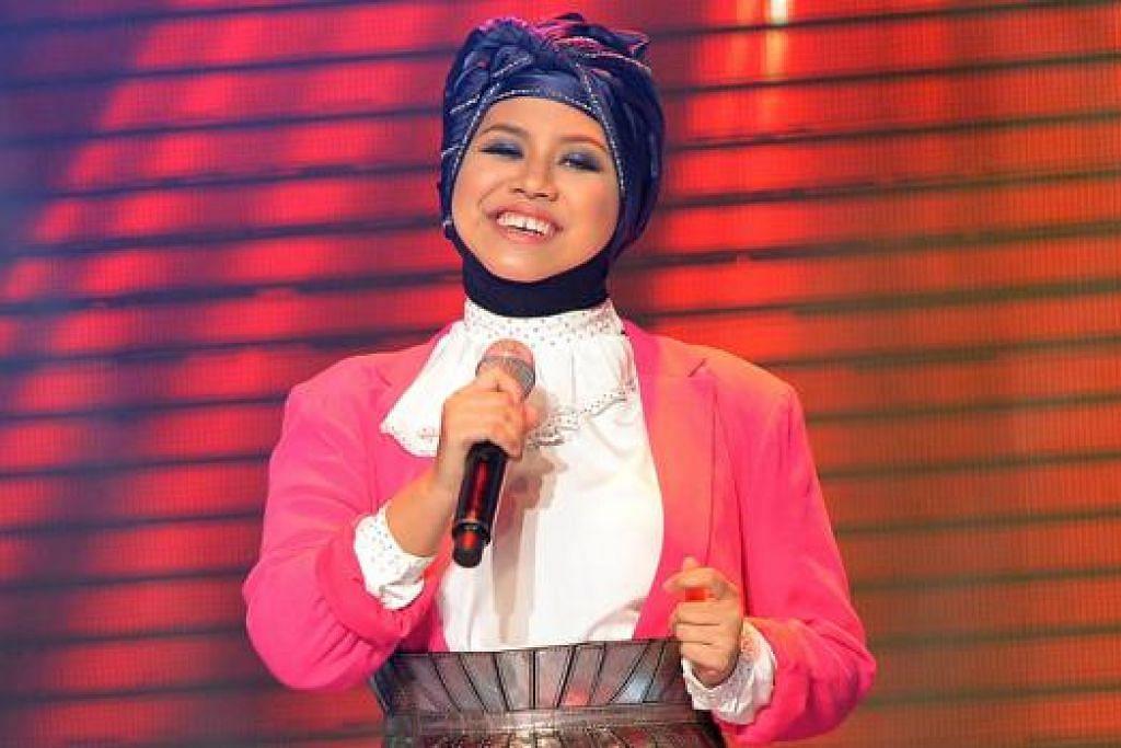 BERSYUKUR DIBERI PELUANG: Fathin Amira Zubir tidak mudah berputus asa dan akur akan bekerja lebih keras bagi mengenalkan ramai kepada identiti diri dan muziknya. - Foto M.O. SALLEH