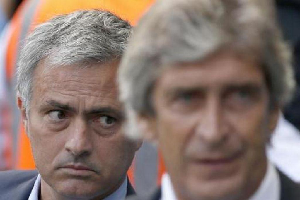 TERUS BERTELINGKAH: Pellegrini (kanan) menuduh Chelsea, yang dipimpin Mourinho, sebagai kelab 'kerdil' kerana terlalu banyak bertahan. - Foto REUTERS