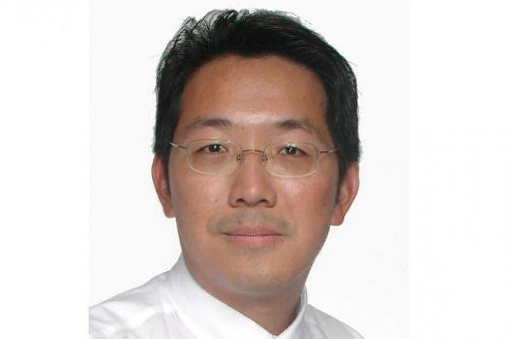 ENCIK LEE YUEN WAI: Mengupas topik membangunkan pengurusan dana syariah di Singapura di seminar. - Foto fail