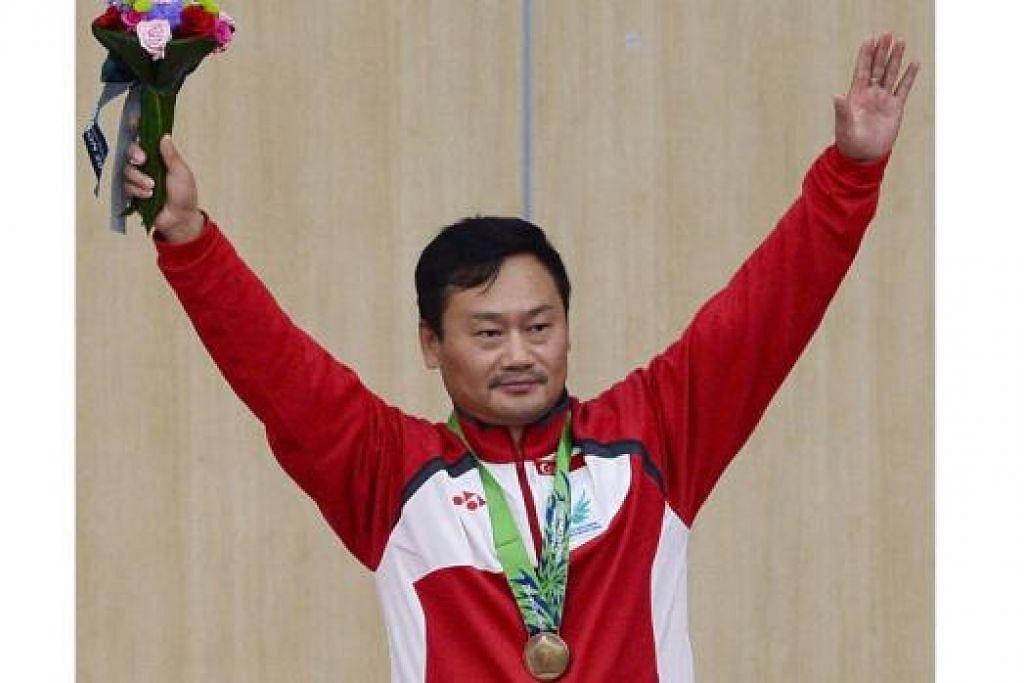 KEBANGGAAN NEGARA: Gai Bin meraih pingat gangsa kedua dalam acara menembak. - Foto AFP