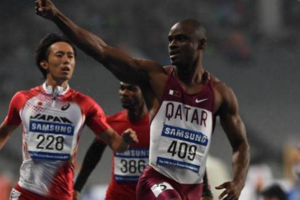 WAKILI 'NEGARA ANGKAT': Femi Ogunode (kanan) yang berkelahiran Nigeria tetapi mendapat kerakyatan Qatar pada 2009 tampil sebagai pelari terpantas Asia kelmarin. - Foto AFP
