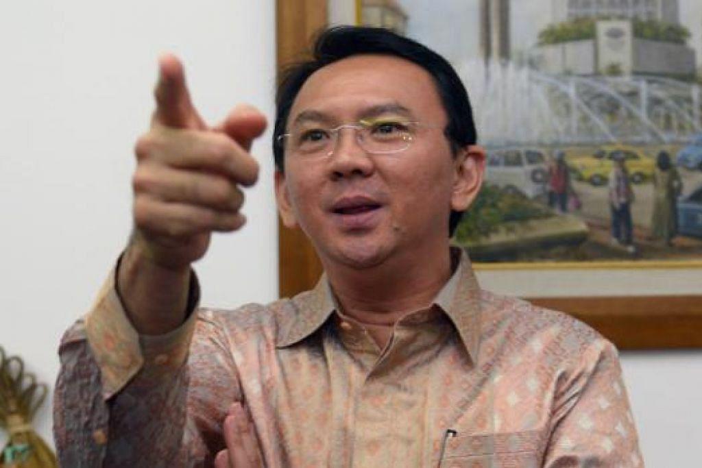 ENCIK BASUKI: Dijangka jadi gabenor etnik Cina yang pertama di Indonesia selepas Encik Jokowi meletak jawatan. - Foto AFP