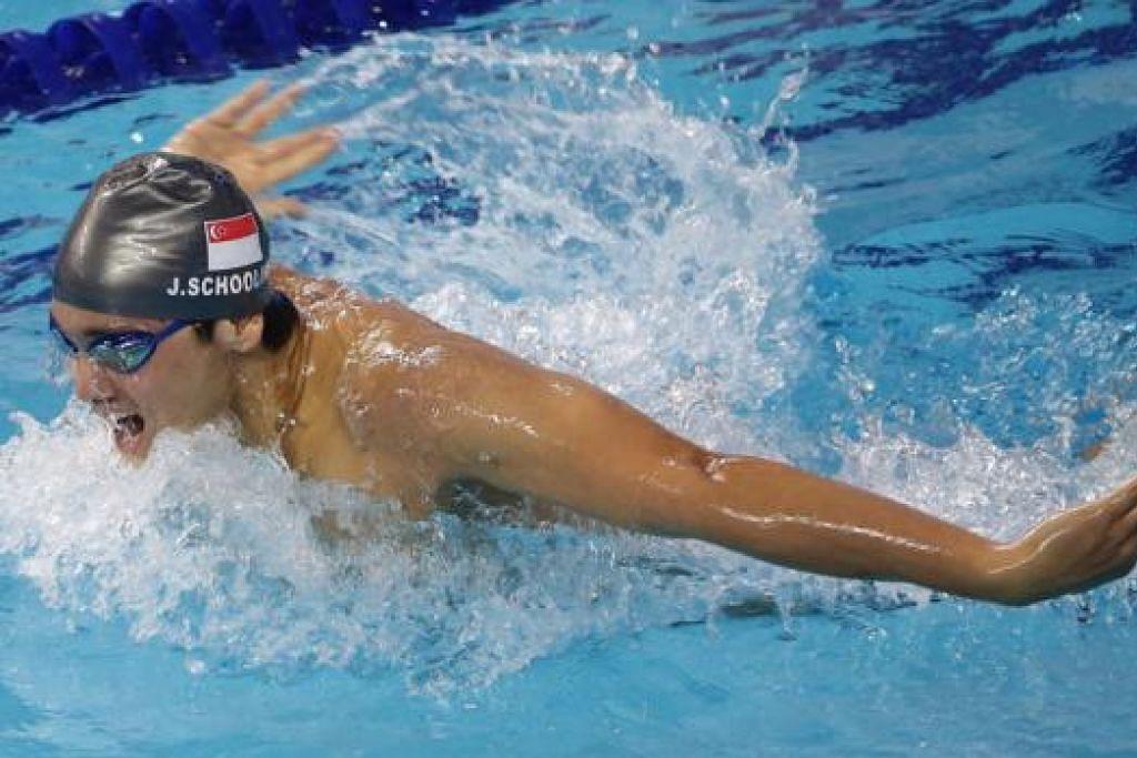 PERENANG EMAS: Joseph Schooling memenangi tiga pingat - satu emas, satu perak dan satu gangsa serta mencatat rekod Sukan Asia dalam acara 100 meter gaya kupu-kupu.
