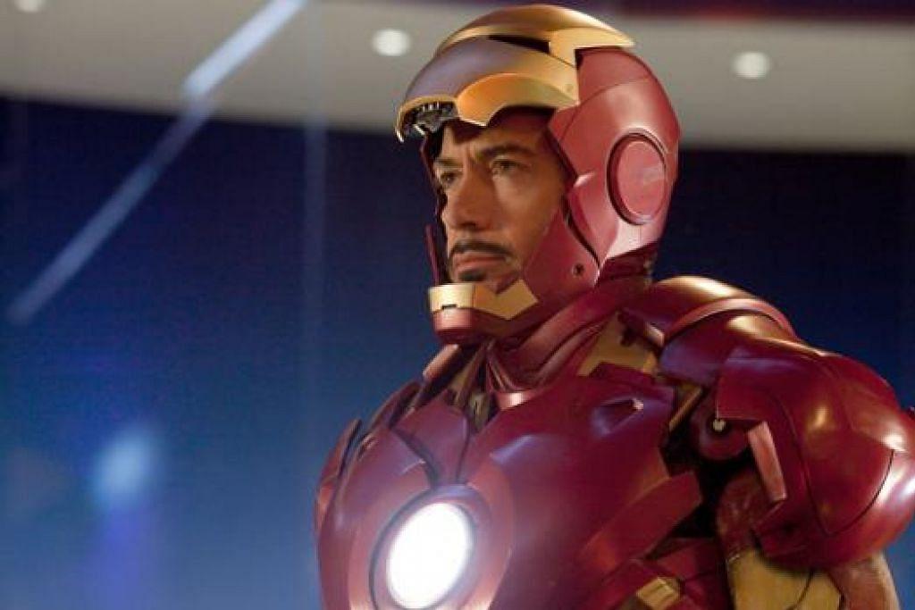 FILEM BERBEZA: Jika dahulu Robert Downey Jr. lebih terkenal menerusi watak Iron Man (atas), kini beliau melakonkan pula watak seorang peguam yang membela bapanya sendiri. Filem itu turut diterbitkan oleh isterinya, Susan. - Foto REUTERS dan fail