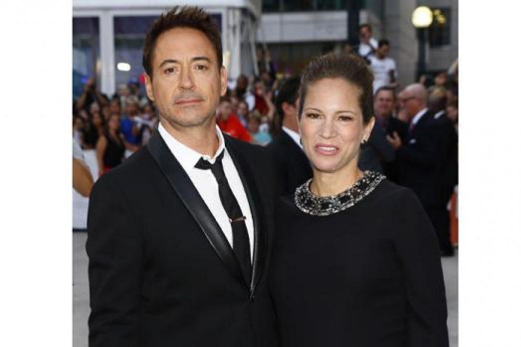 FILEM BERBEZA: Jika dahulu Robert Downey Jr. (kiri) lebih terkenal menerusi watak Iron Man, kini beliau melakonkan pula watak seorang peguam yang membela bapanya sendiri. Filem itu turut diterbitkan oleh isterinya, Susan (kanan). - Foto REUTERS dan fail
