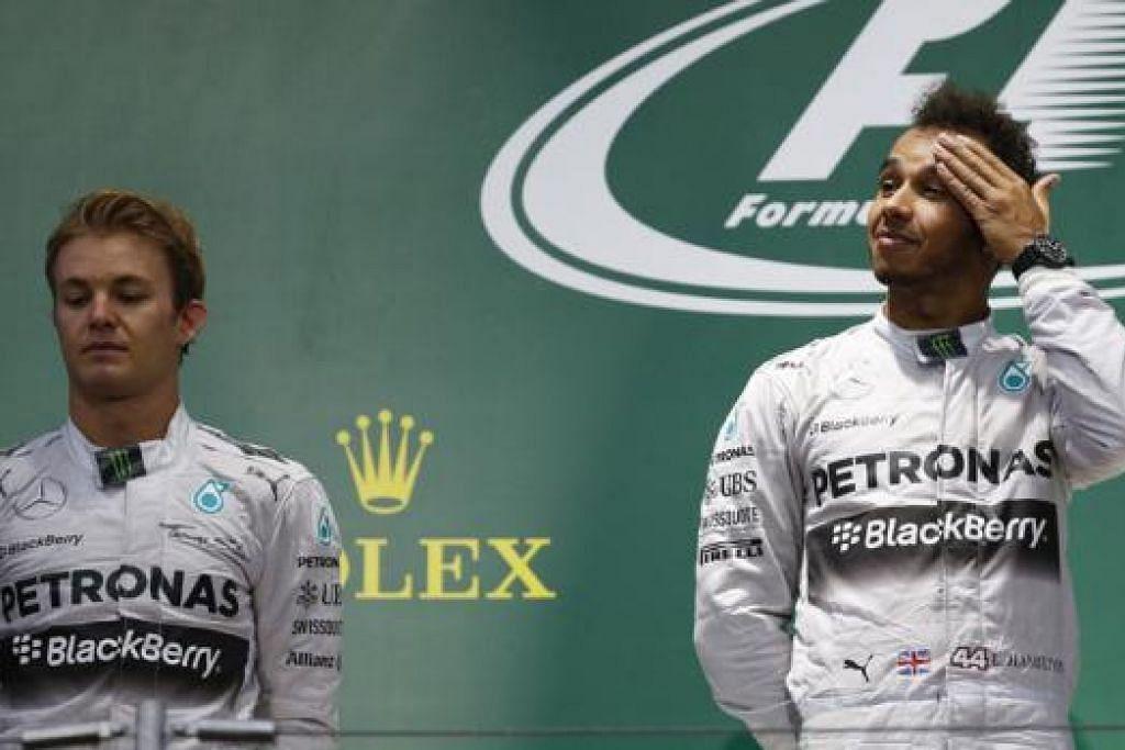 MENANG TAPI MURAM: Lewis Hamilton (kanan) kini mendahului kejuaraan dengan kelebihan 10 mata ke atas rakan sepasukan di Mercedes, Nico Rosberg (kiri), selepas memenangi Grand Prix Jepun. - Foto REUTERS
