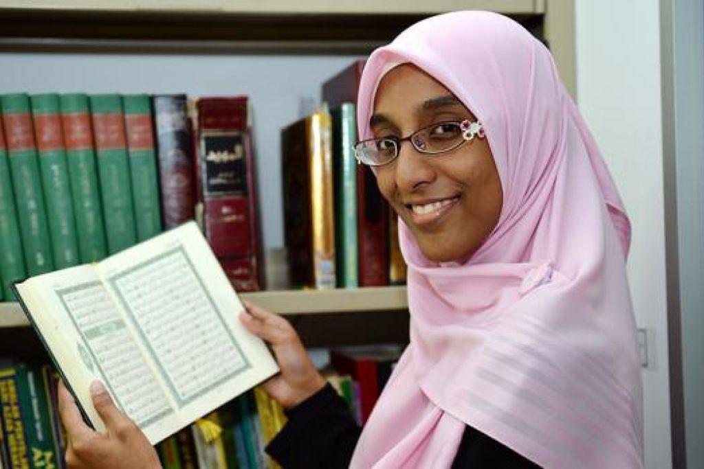 HASIL USAHA GIGIH: Walau sibuk belajar dalam jurusan kejuruteraan di SIT, Cik Nurzahidah mampu menghafal 30 juz Al-Quran dalam tempoh empat tahun. - Foto-foto M.O. SALLEH