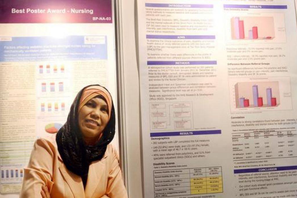KAJIAN MENGENAI SAKIT: Cik Jamilah memenangi Anugerah Gangsa bagi Poster Terbaik untuk kajiannya mengenai pesakit yang mengalami sakit tulang belakang. - Foto TAUFIK A. KADER