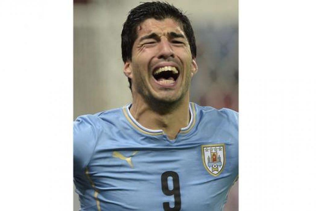 SUAREZ: Diizin beraksi dalam perlawanan persahabatan bagi pasukan Uruguay tetapi masih dilarang bermain dalam lapan lagi perlawanan untuk negaranya di peringkat kompetitif. - Foto AFP