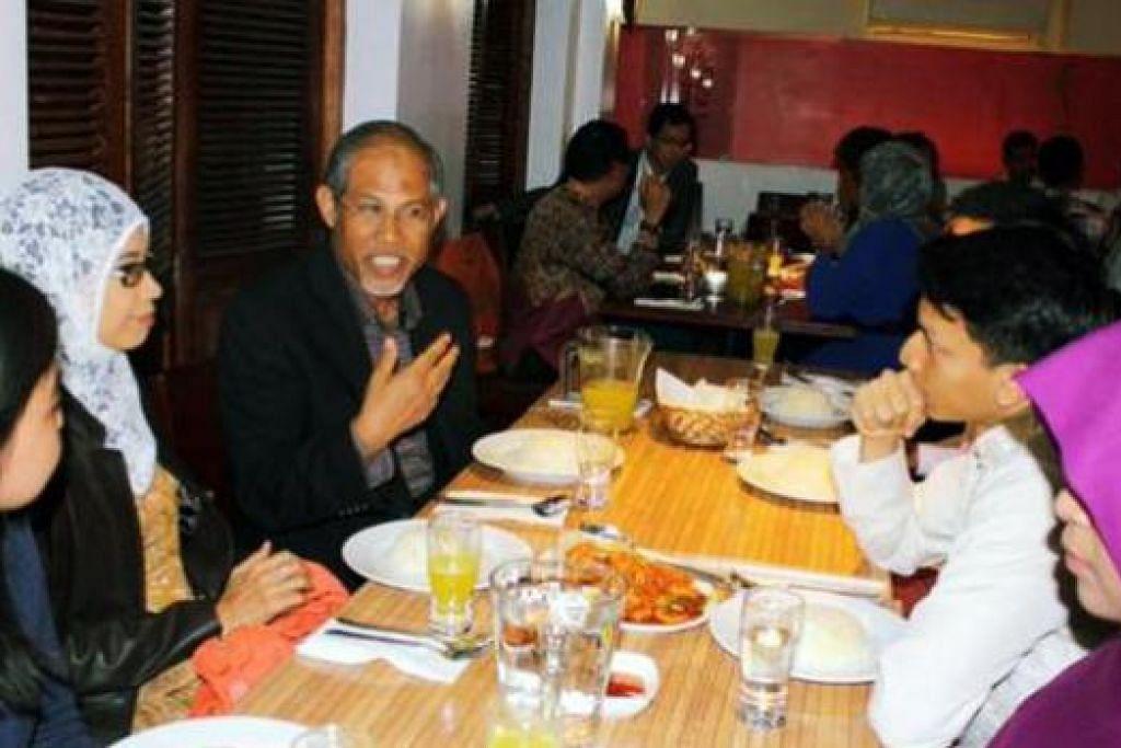 BERBINCANG: Encik Masagos Zulkifli berbincang bersama jawatankuasa SMSO Britain. - Foto-foto SMSO Britain