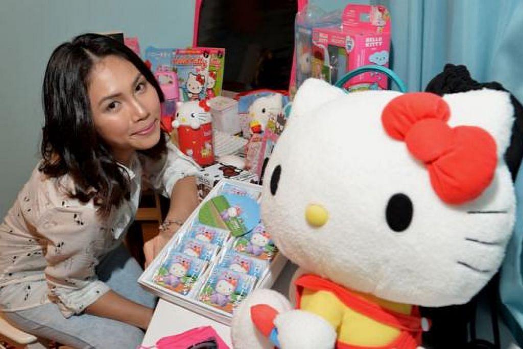 MINAT KUCING: Watak Hello Kitty mengingatkan Cik Nadzirah Razali, 28 tahun, tentang 10 ekor kucing peliharaannya. - Foto TUKIMAN WARJI