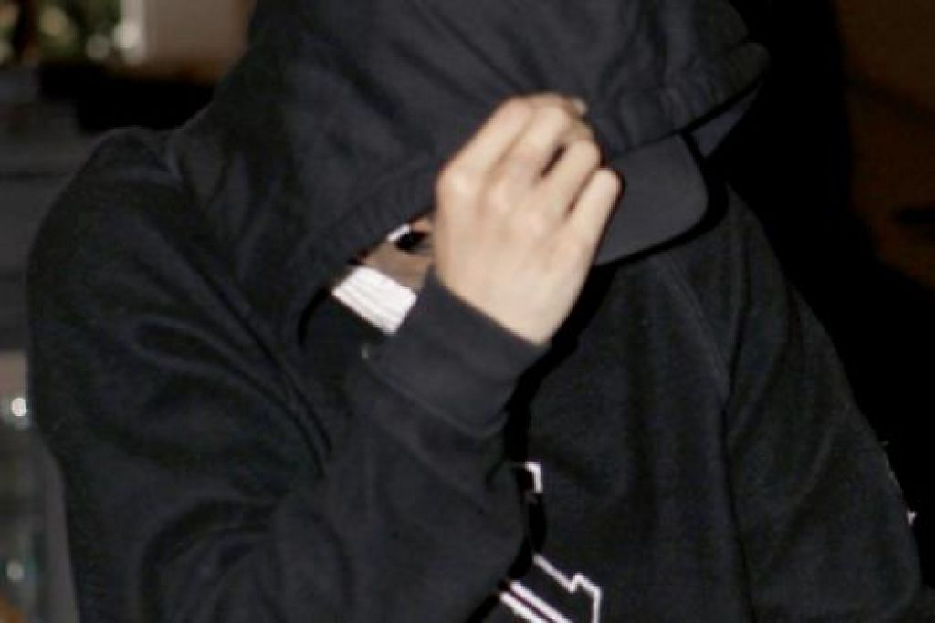 MOHAMMAD AZHAR: Mengaku bersalah bagi tujuh daripada 59 tuduhan. - Foto THE STRAITS TIMES