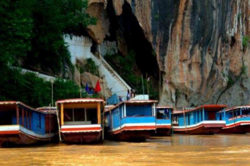 PEMANDANGAN INDAH DAN TENANG: Inilah Pak Ou Cave, sebuah gua ibadat bagi penganut Buddha. - Foto-foto MOKSIM SALEH