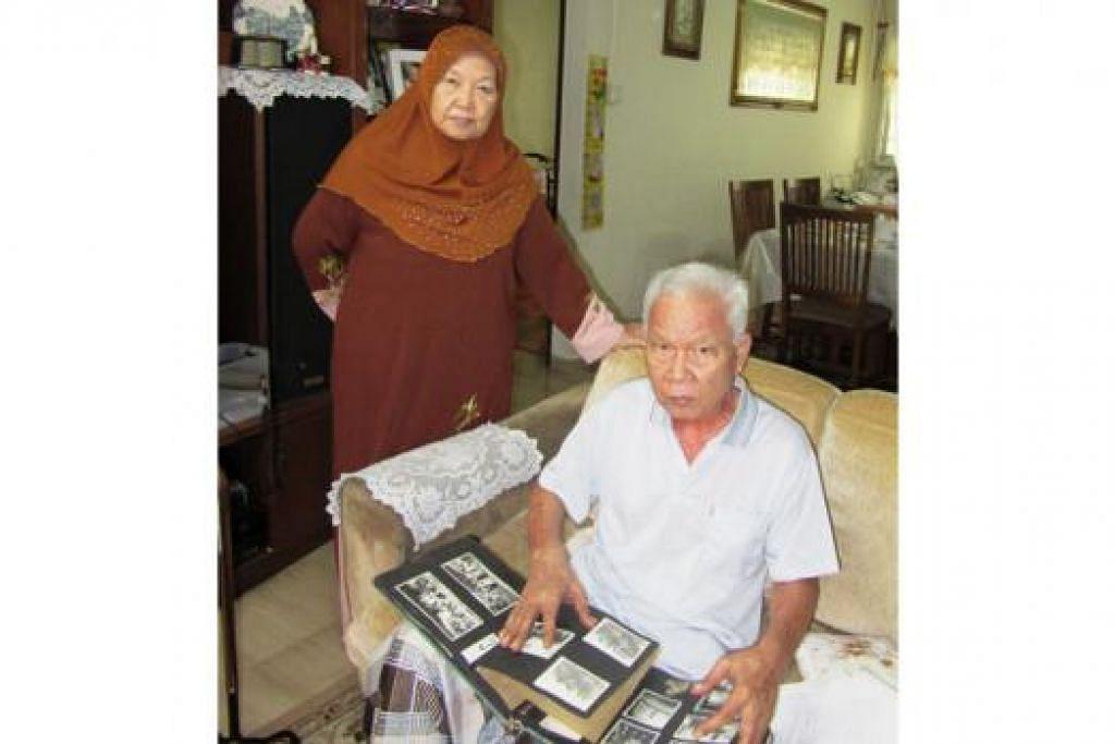 HANYA KENANGAN: Encik Burhan dan isterinya, Cik Alijah Abbas, meneliti gambar-gambar dan dokumen lama yang banyak menyimpan kenangan dan kehidupan keluarganya di Jalan Pisang.