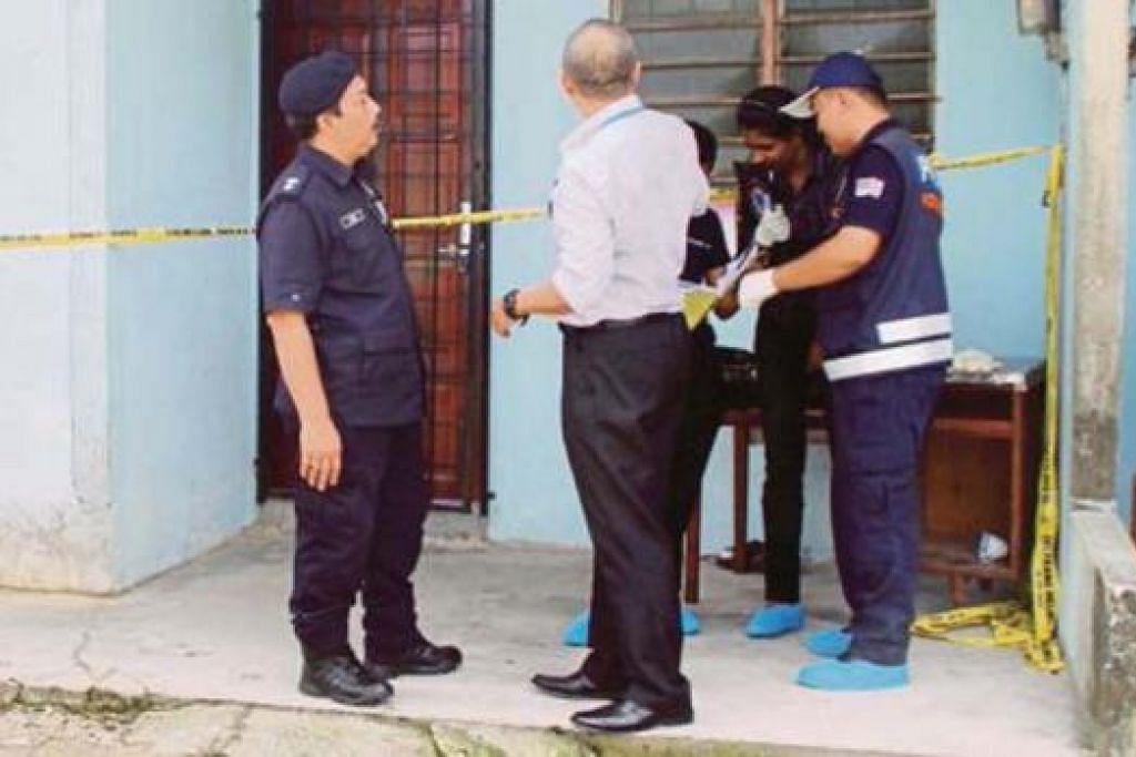 JALANKAN SIASATAN: Penyiasat polis di luar unit rumah panjang yang dipercayai berkaitan dengan pembunuhan kejam 18 warga Myanmar. - Foto NSTP