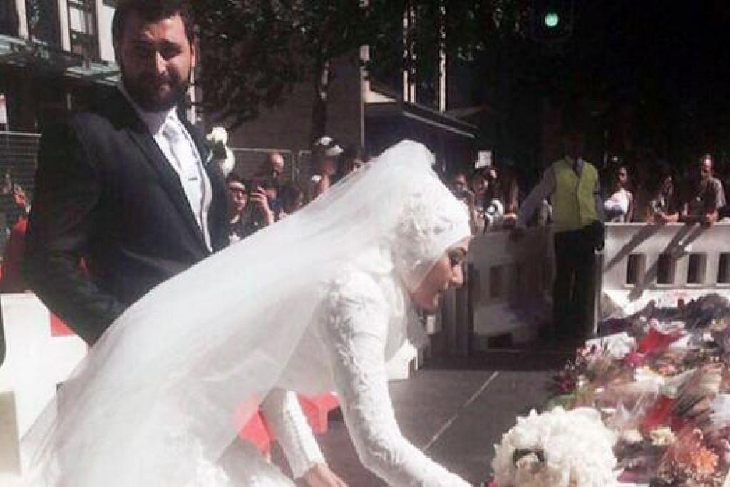 TURUT BERSIMPATI: Pengantin baru Cik Manal Kassem yang anggun dalam busana pengantin serba putih bersama hijab, meletakkan jambangan bunga ros putihnya, sambil ditemani suami, Encik Mahmod Homaisi. - INSTGRAM DINA KHEIR