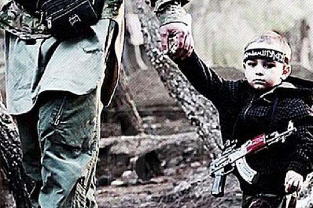 MAHU DIPULANGKAN: Ibu kepada kanak-kanak berusia tiga tahun, Ismail (gambar), mahu budak itu dipulangkan kepadanya setelah bapa budak itu, yang membawa budak itu ke Syria, terbunuh dalam pertempuran di negara itu. - Foto UK TELEGRAPH